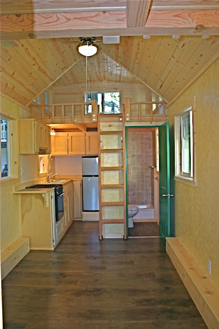 This is about the best layout I've seen in one of these tiny, trailer-bed homes. Molecule Tiny Homes