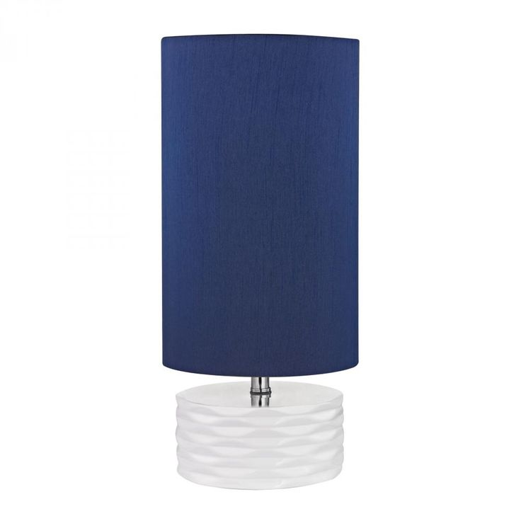 Update a little girls room to teen transition in no time! The Tamworth table lamp by Diamond is a mature, feminine fixture that offers a polished white base and navy blue, faux silk shade.