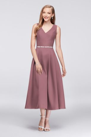 Drawing upon the high-fashion heritage and breathtaking details of Oleg Cassini's opulent wedding gowns, this structured mikado tea-length bridesmaid dress features a flattering V-neckline, handy side pockets, and a crystal-embellished grosgrain waistband.  Oleg Cassini, exclusively at David's Bridal  Polyester  Back zipper; fully lined  Dry clean  Imported