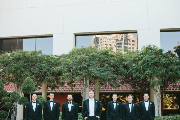 Great Gatsby Themed Wedding at Omni Hotel — Dallas-Fort Worth Wedding Planning Studio - Groom in white tie and tails and groomsmen in regular tuxedo's with black bow ties.