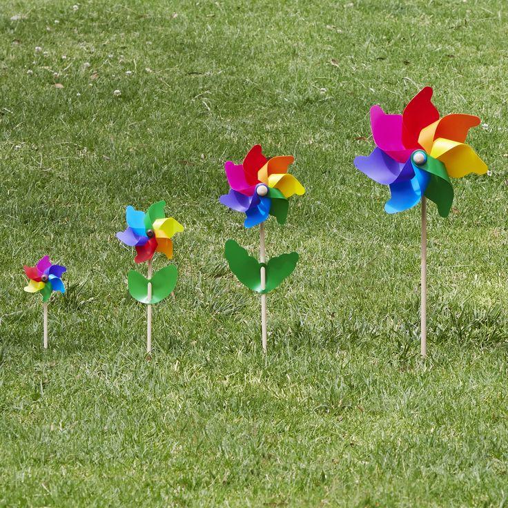 Mini, Cino, Mezzo, Grande in height order.......#rainbow #garden #whirlywindmills