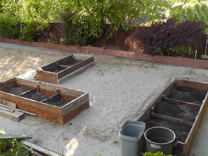 Great idea Raised beds made from repurposed fence boards