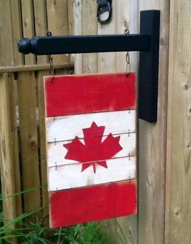 This wooden flag comes as a 5 pc one as shown in first picture and also can be made as 4 pc flag if preferred - 3rd picture select preference as well as orientation Rustic flag approx 8 5 X 11 hangs from wooden bracket included in both 2 sided versions made from reclaimed spindle black exterior paint is used