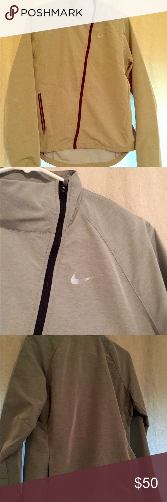 Nike Asymmetrical Jacket Lightweight, waterproof jacket. Perfect layering or transitional piece. It's a light grey color. Nike Jackets & Coats