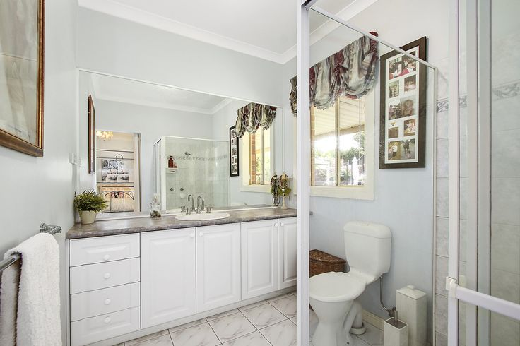 The ensuite to the second bedroom. a BIG cabinet that holds plenty and space to move in this light room. Always feels fresh and clean...