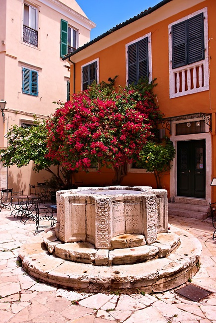 1690 Venetian well of Antonio Cocchini.  Campiello area of Corfu Old Town, Greek Ionian Islands