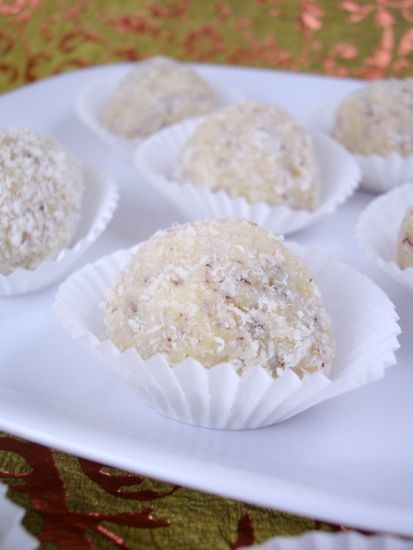 Coconut Ladoo is one of my favorite coconut dessert recipe to date. Just a few ingredients, a few minutes in the kitchen and you are ready for a heavenly experience with soft-on-bite rich coconut sweet. Coconut Laddu make for perfect after meal nibbles or a party dessert.