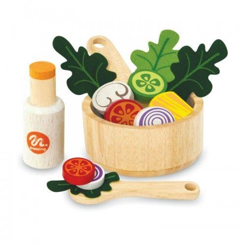 This salad set is comprised of a wooden bowl, fruit and vegetables, salad utensils and a salad dressing bottle.