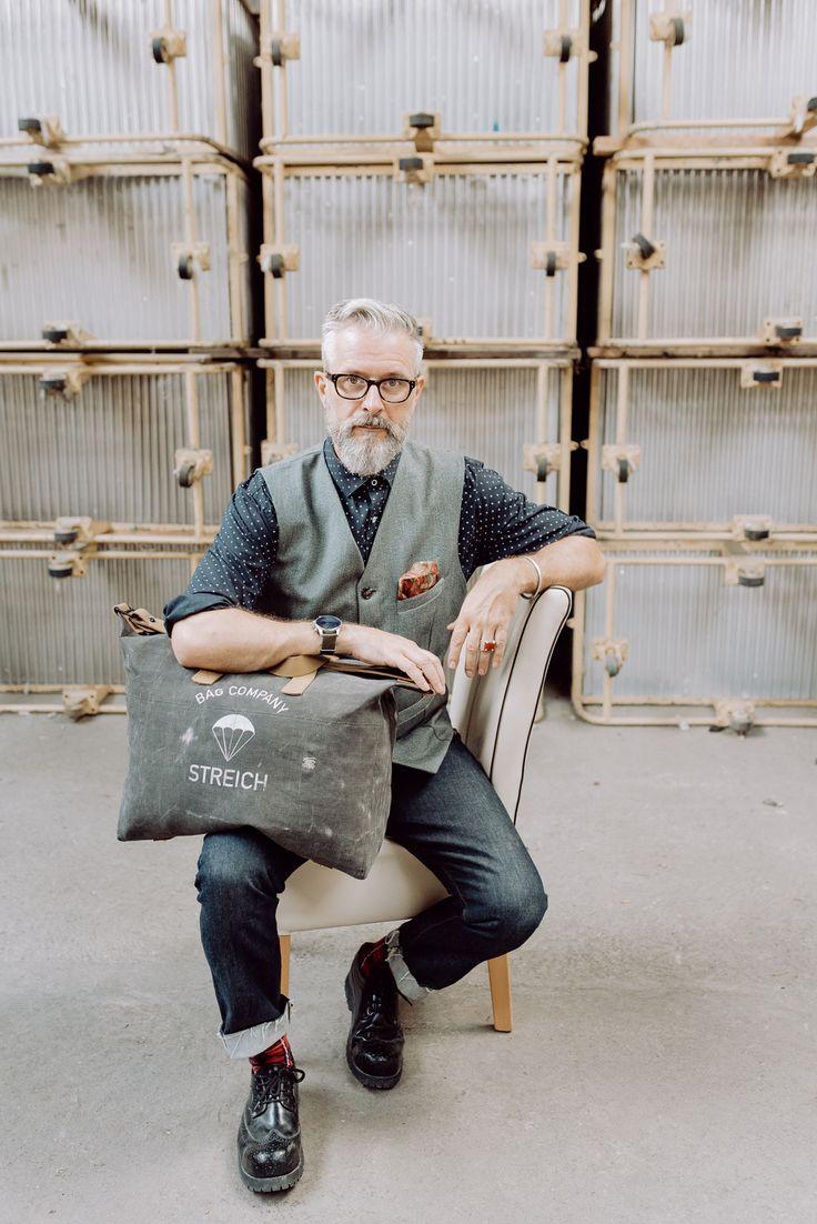 STREICH:  SOHO bag out of swiss army tent canvas and french army gunbelts. #streichbag #brunostreich #CANVASBAG #ARMYSTYLE #WEEKENDERBAG #WEEKENDER #waistcoat #beard #beardmodel #saltandpepper #glasses #waistcoat #denim #selvedgedenim