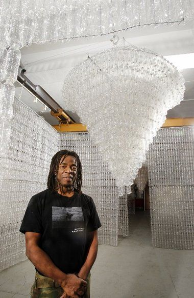 Earth Day: Artist Willie Cole recycles water bottles into chandeliers for From Water to Light #art #earthday
