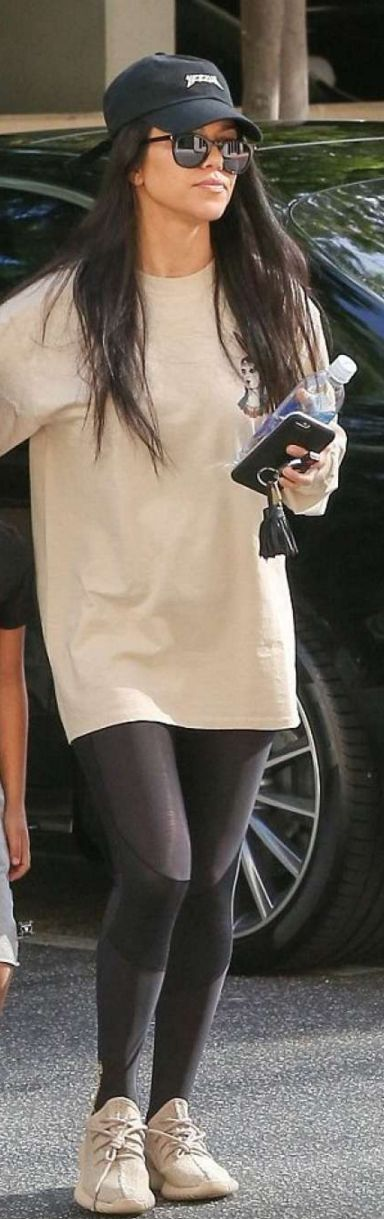 Kourtney Kardashian: Hat – Yeezus  Bracelet – Cartier  Key Chain – Hermes  Pants – Skins  Sunglasses – Saint Laurent
