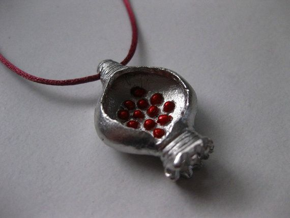 Pomegranate lucky charm 2014. Rhodiumplated bronze by Tsalapatis jewelry