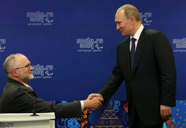 Vladimir Putin Photos Photos - (L-R) Sir Philip Craven the President of the International Paralympic Committee and Vladimir Putin the President of Russia shake hands prior to the Opening Ceremony of the Sochi 2014 Paralympic Winter Games at Fisht Olympic Stadium on March 7, 2014 in Sochi, Russia. - Paralympic Winter Games Opening Ceremony