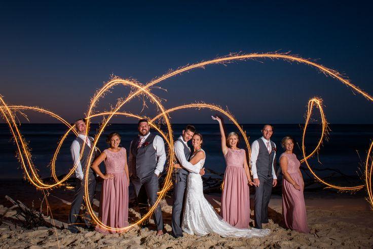 Beautiful bridal party with sparklers fun.   North Stradbroke Island stradbrokeislandphotography.com