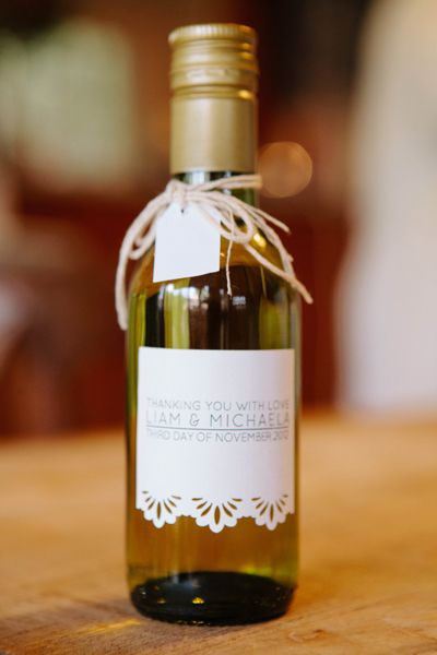 Personalised labels turn wine, jam or homemade relishes into memorable bomboniere. Michaela and Liam bottled their own wine. Image: PVH Photography