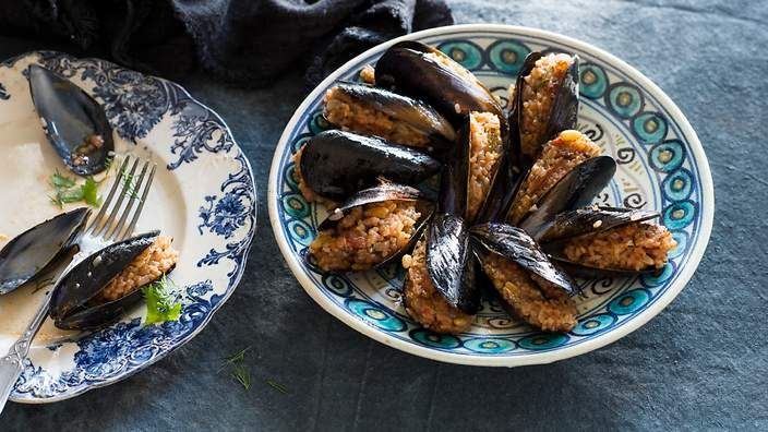 Aromatic rice-stuffed mussels (midye dolma). These are a popular street-hawker-style dish in Istanbul. Listen to the audio recipe.