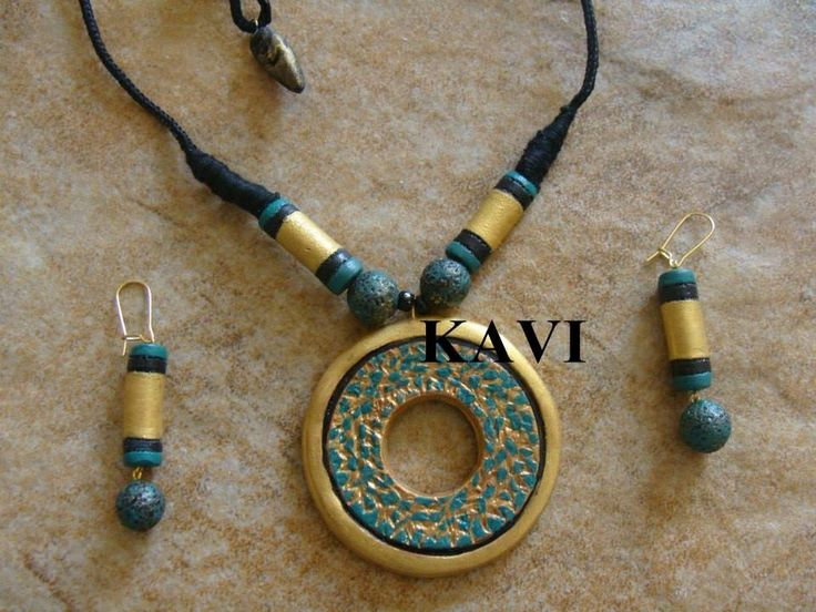 Circle shaped handmade terracotta jewelry painted on green & gold https://www.facebook.com/KavisTerracottajewellery