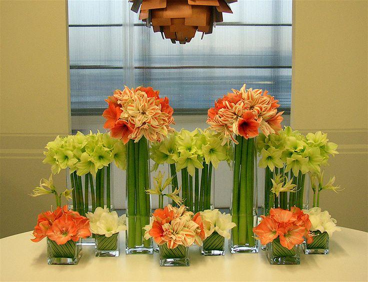 Oscar Mora Floral Art & Design.  bright orange, lime green & white lily.