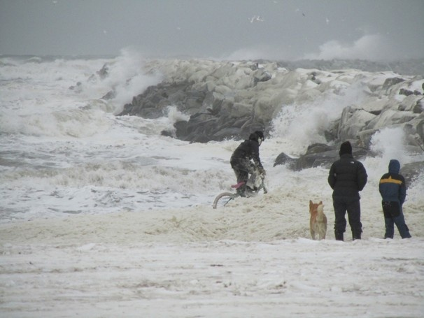Nov. 8, 2011 Children play in sea foam near the harbor as the Bering Sea storm starts kicking up in Nome, Alaska.  Peggy Fagerstrom / AP