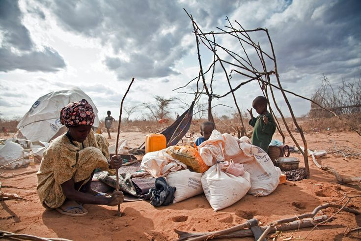 A refugee uses twigs and scraps of material to build a shelter for her family. There is no room for most new arrivals in the Dadaab camps, so the thousands of people who arrive every week must carve out a place for themselves in the surrounding desert. Doctors Without Borders estimates that by the end of 2011 there will be 500,000 people living in and around the camps, which were originally built to accommodate 90,000 Dadaab refugee camp - Photos - The Big Picture - Boston.com