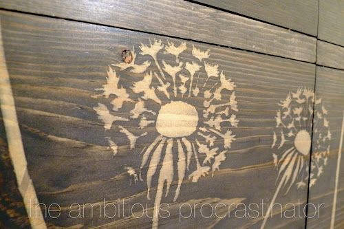 """Using wood glue to """"paint"""" in a stencil to resist wood stain."""