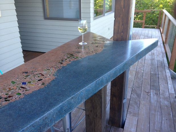 "Concrete and Beach Glass Bar Countertop ~ Beautiful DIY project includes sea glass they found & collected over the years.  Bar mimics the beach, with blue for the ""ocean"" & brown for the ""sand"" - very creative"