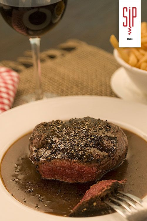'Our Famous Pepper Steak'  Sautéed Organic Australian Beef Tenderloin, Madagascar Black Peppercorn Sauce with the Chef's 'Quiet Twist', Potato Maxim's or French Fries
