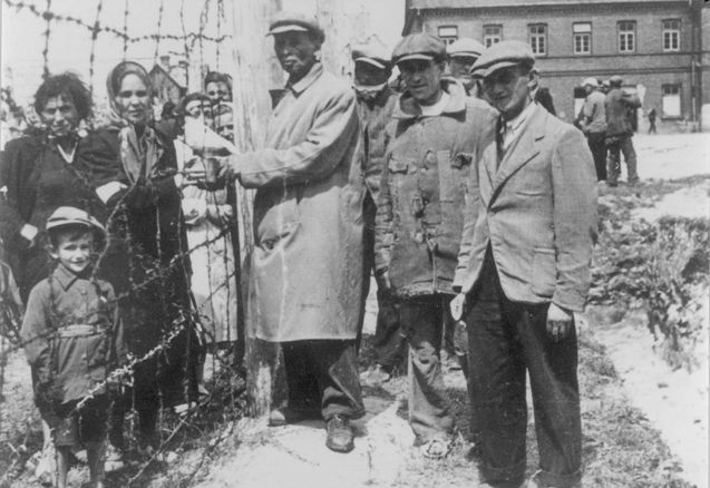 Biala, Poland, Families meeting near the fence of the Biala Camp, June 1940.