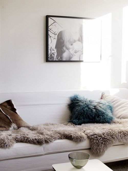 Mongolian fur is a great way to make any room super cosy and mixing this with reindeer rugs and cow-hide gives a room an ultra luxurious feel. Keep tones muted and add subtle art work to walls for simple city living.....x