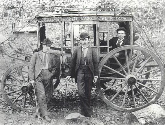 """Jesse James and the Younger Brothers were fond of robbing stagecoaches near Hot Springs, AR. Apparently, it was something to brag about. Here's a photo of three Arkansas men who were robbed of $3000 and some valuables. They commemorated the event by painting """"Robbed by Jesse James January 15, 1874"""" on top of their stagecoach. This was supposedly the first of a string of James-Younger holdups on the road between Malvern and Hot Springs."""