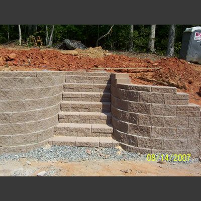 Stairs between two retaining walls.  This is what I would like to do out front/side of driveway.  Anyone have a spare bag of money?