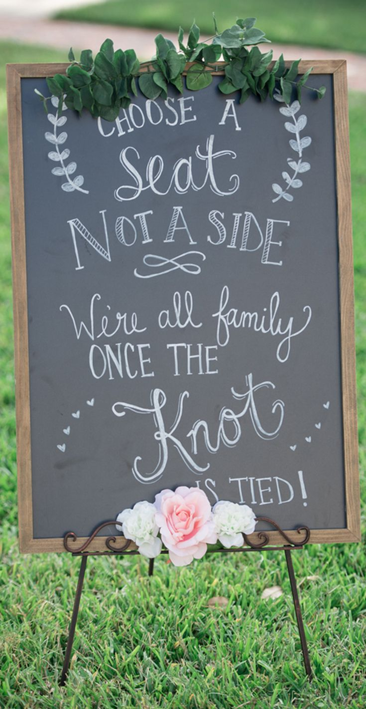 """We love thepersonalized signsfrom this rose wedding.A wooden sign welcomed guests and a chalk sign read """"Choose a seat, not a side. We're all family once the knot is tied!"""" 