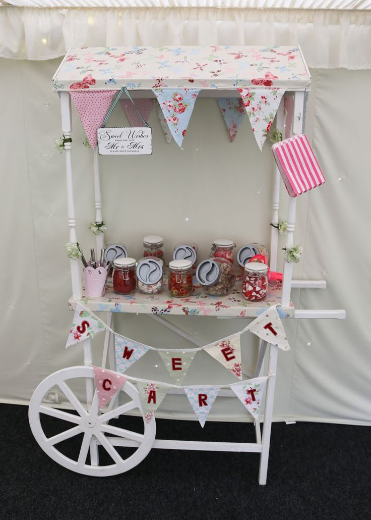 Sweet cart hire £50 includes cart, bunting,10 empty jars, and sweet bags in your colour choice.