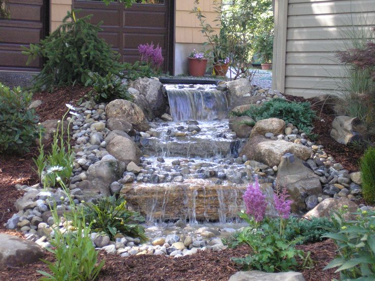 Pondless waterfall diy pond ideas water gardens for Waterfall garden feature