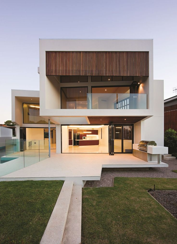 cantilevered concrete slab over lawn