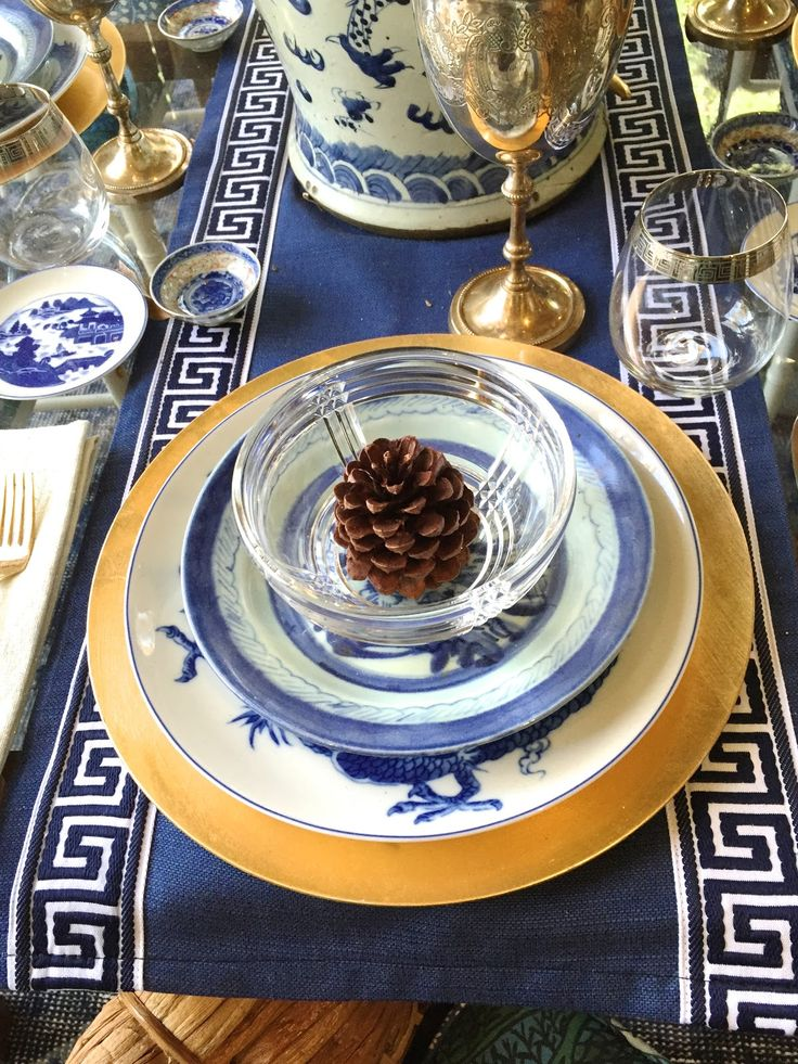 Love this holiday tablescape with the pine cone the center of attention.