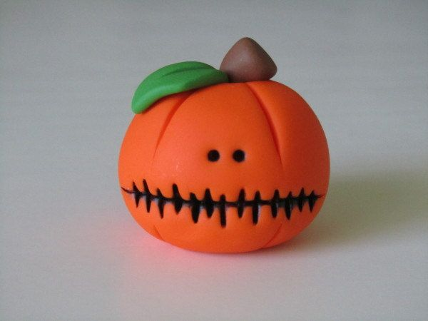 Polymer Clay Halloween Pumpkin. $5,00, via Etsy.