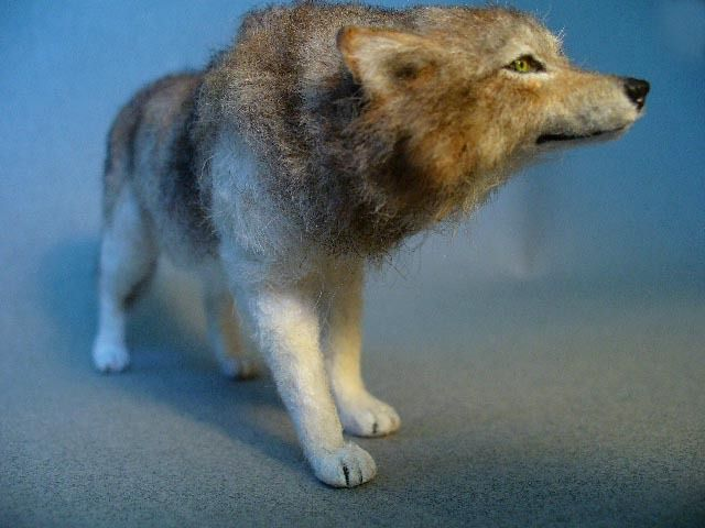 Dollhouse Miniature Wolf. Handsculpted polymer 1:12th dollhouse scale Wolf. Wolf's coat is white alpaca and salt & pepper brown merino/alpaca wool with hand painted markings. Crystal clear yellow glass eyes are hand made and glossed. Tail is adjustable. Wolf has wire armature base and is made without the use of molds.