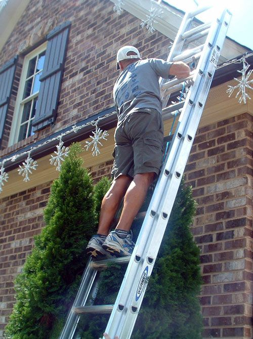 Obviously many homeowners opt for a do-it-yourself outdoor holiday display; however, if you don't want to get tangled in the muss-and-fuss of DIY, just call a neighborhood expert.  When you can have a spectacular and hassle-free exhibit by hiring a little help, maybe it's just best to stay off the ladder. | photo by Outdoor Lighting Perspectives
