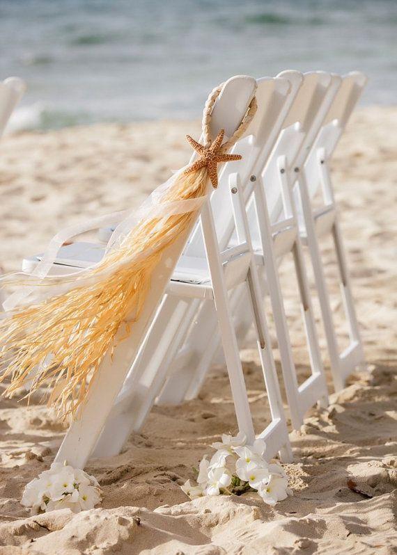 ~ LE PRIX INDIQUÉ EST PAR BOW ~  Plage allée décorations, étoiles de mer et raphia chaise cintres, ces décorations ajoutera beauté à nimporte quel mariage sur le thème de la plage.  Ce sont mes créations originales... chacun deux est main ouvrée individuellement avec soin et attention aux détails.  Première photo montre une brides définie avec les étoiles de mer et coquillages et ruban bleu pure lumière rose et léger... Également sur la photo avec un ruban violet, aqua et vert pomme…