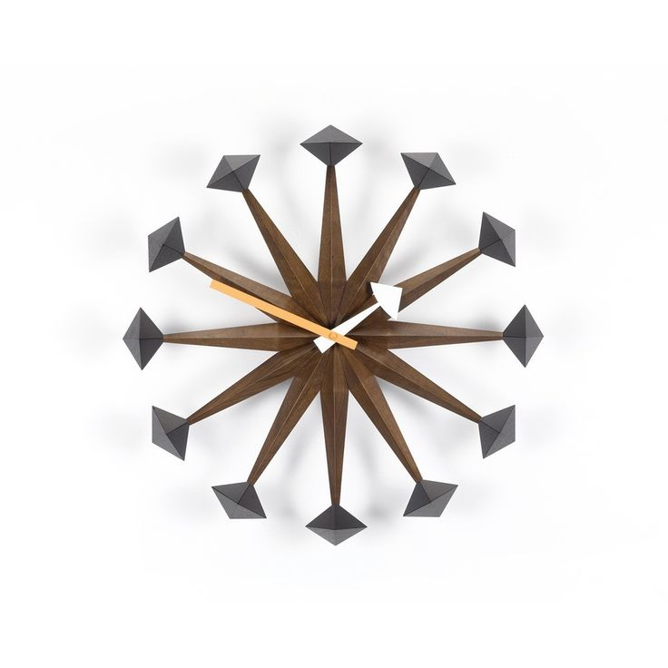 A classic midcentury clock, the Nelson Polygon Clock features walnut spindles that end in hardwood polygon shapes.