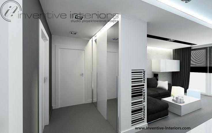 Projekt przedpokoju Inventive Interiors - biało szary przedpokój - naklejka ścienna - oświetlenie szafy