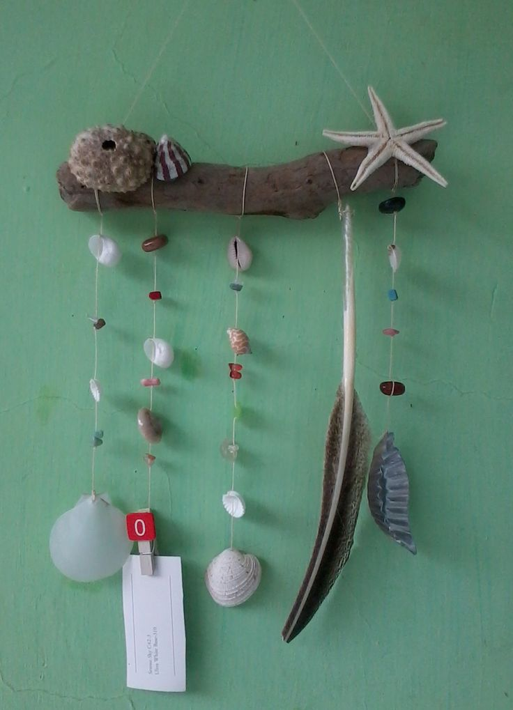 drift wood shell and  feather mobile with memo holder picture