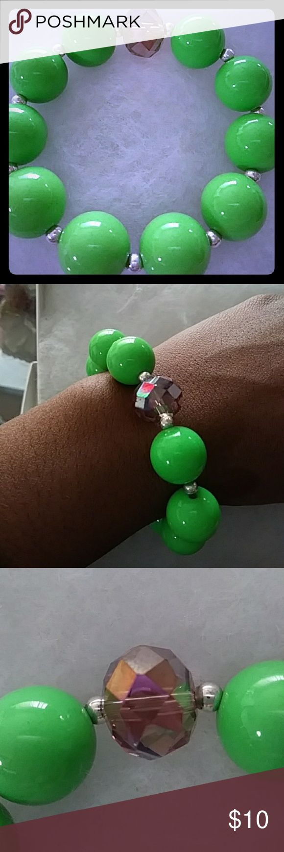 Arm candy Bracelet Apple green beads with silver spacers with a beautiful iridescent crystal stone. Stretchy bracelet, this  is such a fun bracelet Jewelry Bracelets