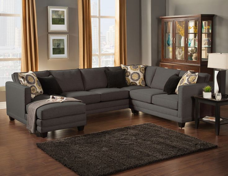 "3 pc Oasis collection Ebony color fabric upholstered sectional sofa with square arms and chaise. This sectional measures 127"" x 64"" chaise x 98"" L x 35"" H x 38"" D. Also available in Almond, willow, and Teal colors. This item is made in the U.S.A. and takes 2-3 weeks for manufacturing. Shipping will take up to 2-3 weeks from warehouse to your home."