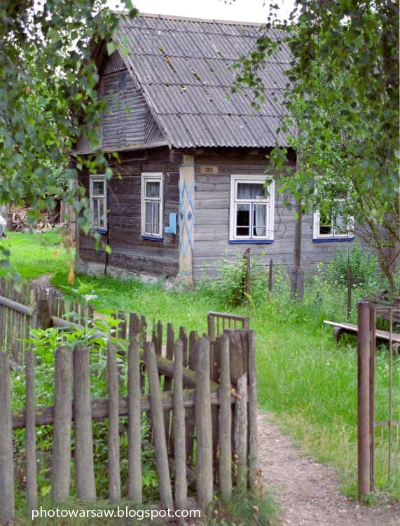 It's old and lovely farmahouse in Belarus. It's so imaginative that on most of these houses are carved motives of cards: clubs, diamonds, hearts, spades.