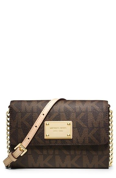 Free shipping and returns on MICHAEL Michael Kors 'Large Jet Set' Crossbody Phone Bag at Nordstrom.com. A muted monogram print defines a compact crossbody phone bag that doubles as a convenient wallet for everyday ease. Logo-engraved heritage hardware and a chain-detailed strap add sophisticated polish.
