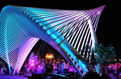 Concerts happen throughout the year under the colorful and futuristic band shell at the Myriad Botanical Gardens in Oklahoma City's Bricktown Entertainment District.