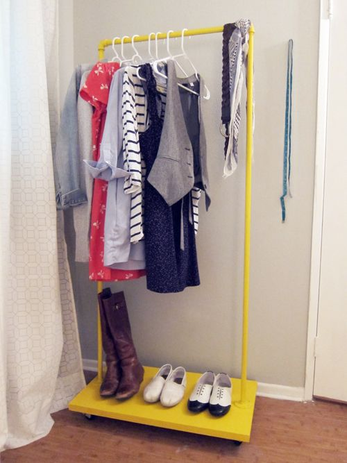 DIY rolling clothes rack.  PVC pipes/elbows could work, too.  This would be awesome for a laundry area, and might even be good for dress-up clothes in the playroom!