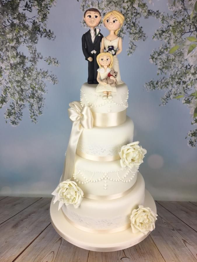 Ivory wedding cake with bride groom and flower girl sugar topper  - Cake by Melanie Jane Sowa
